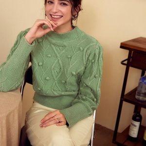Beautiful pompoms knitwear